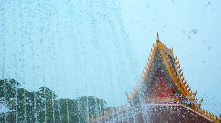 vientiane : Video 1080p - Many jets of water spraying skyward from fountains in front of the intricate ornamentation of this Buddhist Temple in Vientiane. Laos.