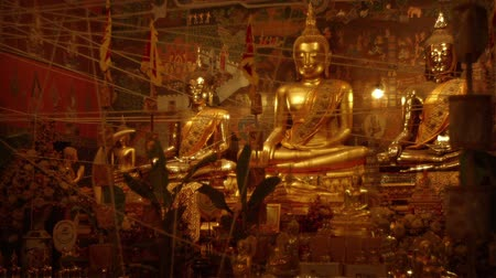 rzeźba : Video 1920x1080 - Immense Gilded Buddha Statues inside Wat Phanan Choeng. an important cultural and Buddhist religious site at Ayutthaya Historical Park. in Thailand.