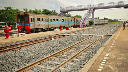 outbound : BANG PA-IN. THAILAND - CIRCA NOV 2013: Passenger train accelerates out of the station after making a stop at Bang Pa-In. Thailand.