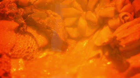 kari : Video 1080p - Delicious. spicy curry. bubbling and simmering in a pot as it cooks in a street food vendors stand in Asia.
