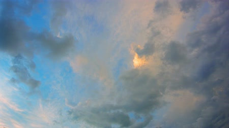 puffy clouds : Video UHD 3840x2160  Looking straight up into the sky as puffy. cotton candy clouds drift by. reflecting near sunset colors of pink and lavender in the fading light.