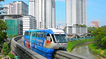 KUALA LUMPUR. MALAYSIA  CIRCA FEB 2015: Two monorail trains pass each other going in opposite directions on a bend in downtown Kuala Lumpur. Malaysias capital city.
