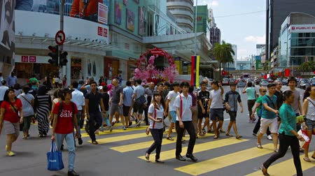 pedestre : KUALA LUMPUR. MALAYSIA  CIRCA FEB 2015: Busy pedestrian traffic crossing a downtown. city street in the central business district of Kuala Lumpur. Malaysia.