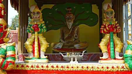 kedah : Video 4k  Collection of Buddhist religious sculptures on display at Wat Tham Kisap. a Thai temple on Langkawi. in the Malaysian state of Kedah.