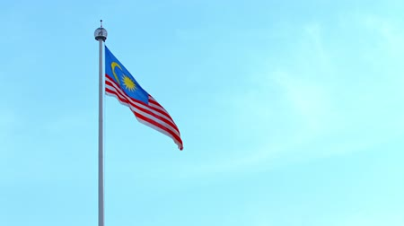 malajské : Malaysian national flag. waving in the steady wind against a clear blue sky. over Merdeka Square. Dostupné videozáznamy