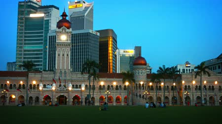 abdul : KUALA LUMPUR. MALAYSIA - CIRCA FEB 2015: Sultan Abdul Samad Building on Merdeka Square. with Contemporary Commercial Office Buildings in the Background Stock Footage