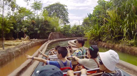 amazonka : SINGAPORE - CIRCA JAN 2015: zoo - Tourists enjoying the water ride at Amazon River Quest. a Popular Attraction in Singapore. in Timelapse