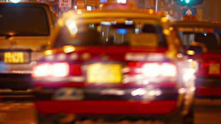 крейсерский : Video 1920x1080 - Four. identical. red and yellow taxis cruise down a brightly lit. busy. urban street at night.