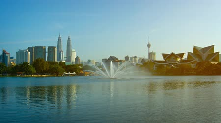 in : Video UHD - Decorative fountain spraying jets of water in multiple directions from the surface of an urban lake in Kuala Lumpur. Malaysia.