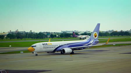 aerodrome : BANGKOK. THAILAND - CIRCA JUN 2015: Nok Air Airliner Taxis towards Runway at Don Mueang International Airport in Bangkok. Thailand