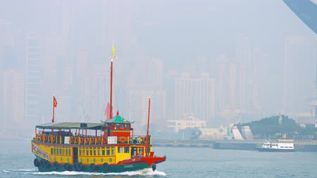 double happiness : HONG KONG. CHINA - CIRCA JAN 2015: Brightly colored. Double deck. passenger. motor launch. operated by Wing on Travel. in the waters off Hong Kong.