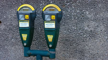 prepaid : MACAU. CHINA - CIRCA JAN 2015: Automated. digital parking meters on a curb in downtown Macau. China.