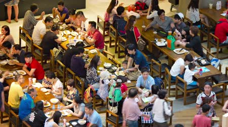 meal : SINGAPORE - CIRCA AUG 2015: Crowded food court inside the Shoppes at Marina Bay Sands. a major shopping destination in Singapore. Stock Footage