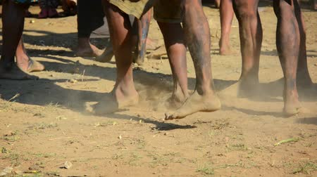 stomping : Native men of a remote. Burmese village. stomping a barefoot dance on the dusty ground to celebrate a local festival. Video 1920x1080