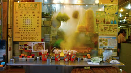 restoran : HONG KONG. CHINA - CIRCA JAN 2015: Steam rises from cooking food in the kitchen of a popular noodle shop in Hong Kong. China.