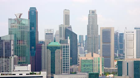 glass building : Beautiful and modern. highrise architecture of Singapores famous skyline. forming a concrete and glass jungle under an overcast sky. 4k video Stock Footage