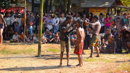 aborigine : MON STATE. MYANMAR - CIRCA JAN 2014: Traditional burmese entertainment with music. dances and competition. Young men compete to reach a main prize on the top of slick bamboo pole. Stock Footage