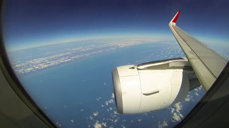 curvature : Earths Curvature is visible under the wingtip and engine cowling of an airliner. as seen through the passenger window at high altitude. UltraHD video Stock Footage