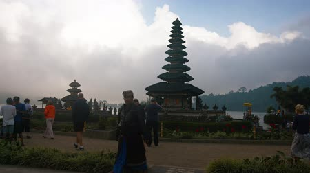 bratan : BALI. INDONESIA - CIRCA JUL 2015: Tourists snap photos of Pura Ulun Danu Bratan. a lakeside Hindu temple complex on Bali. in indonesia. Video 3840x2160