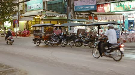 curbside : SIEM REAP. CAMBODIA - CIRCA NOV 2015: Motor rickshaws parked curbside. awaiting passengers in Siem Reap. FullHD video