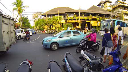curbside : KUTA. BALI. INDONESIA - CIRCA JUL 2015: Motorbike parking and traffic jam in the popular tourist area in Kuta. Stock Footage