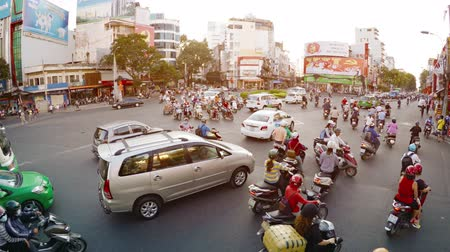 chi : HO CHI MINH CITY. VIETNAM - CIRCA JAN 2016: Uncontrolled Traffic through Phu Dong Roundabout in Ho Chi Minh City. Video 4k Stock Footage