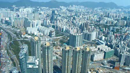 örneklemek : Hundreds of highrise buildings exemplify Hong Kongs modern Architecture from an overlooking perspective atop Sky 100 observation deck. 1080p footage Stok Video