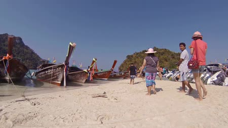 speedboats : TUP ISLAND. THAILAND - CIRCA FEB 2015: Many tour boats tied on the sandbar at Tup Island in Thailand. Video 1080p