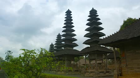 tiered : Fascinating architecture of Pura Taman Ayun a Royal Hindu Temple with its tall tiered pagodas under a cloudy sky in Bali, Indonesia. Video 4k 2160p