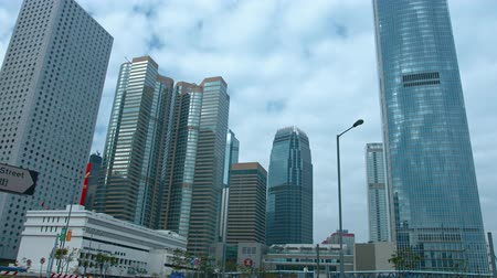 uzun boylu : HONG KONG. CHINA - CIRCA JAN 2015: Tall buildings tower over urban highway in Hong Kong. with sound. 4k 2160p footage