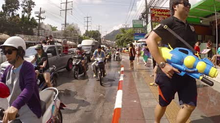squirting : PATONG. PHUKET. THAILAND 13 APR 2016: Celebrants dancing and splashing in the streets at Songkran Festival in Patong. Thailand. 4k 2160p footage