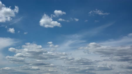 puffy clouds : Abstract timelapse clip of peaceful puffy clouds building and drifting across bold blue sky in timelapse.