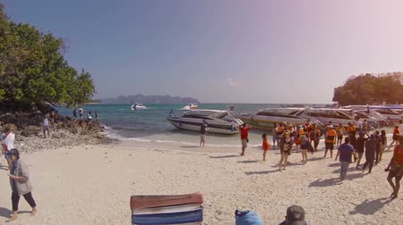 speedboats : TUP ISLAND. THAILAND - CIRCA FEB 2015: Many tourists enjoying the tropical sandy beach at Tup island in Thailand. with sound. FullHD video
