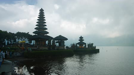 bratan : BALI. INDONESIA - CIRCA JUL 2015: Hindu temple complex on Bratan lake Pura Ulun Danu Bratan. Bali. Indonesia. UltraHD 2160p 4k video