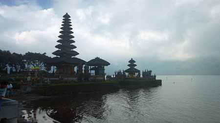 bratan : BAILI. INDONESIA - CIRCA JUL 2015: Hindu temple complex on Bratan lake Pura Ulun Danu Bratan. Bali. Indonesia. Video with horizontal panning