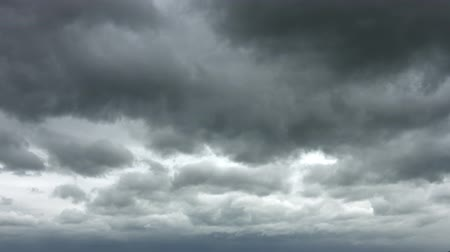 impending : Heavy and ominous. dark gray clouds drift slowly across the sky. threatening rain. UltraHd 4k video Stock Footage