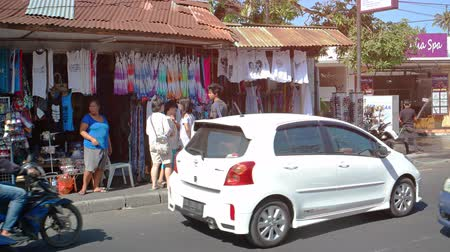 indonesia : BALI. INDONESIA - CIRCA JUL 2015: Streetside Shopping with Typical Traffic in Bali. Indonesia.