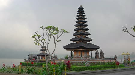 danu : Beautiful tiered pagodas of Pura Ulun Danu Bratan Temple stand over carefully landscaped gardens and flowers in Bali. Indonesia.