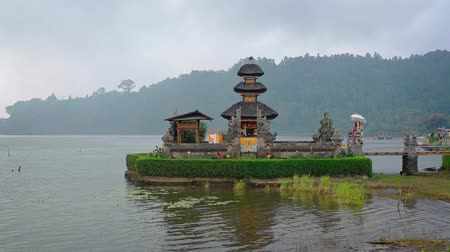 bratan : Beautiful. multi-tiered pagodas and carefully sculpted gardens of Pura Ulun Danu Bratan. a lakeside Hindu temple in Bali. Indonesia.