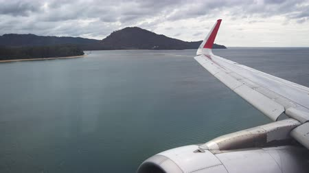 final destination : PHUKET. THAILAND - CIRCA DEC 2016: Commercial Airliner on Final Approach and Landing at Phuket International Airport from Passenger Perspective