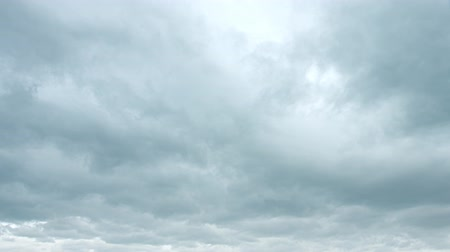 impending : Ominous clouds drift slowly across the sky. threatening rain. UltraHd 4k video