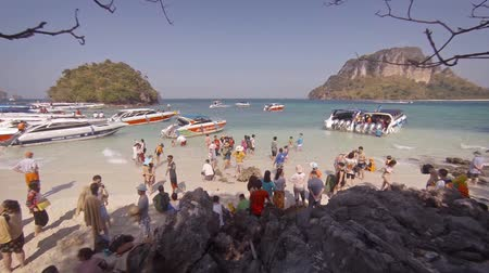 speedboats : TUP ISLAND. THAILAND - CIRCA FEB 2015: Tourists who arrive or leave by speedboat. FullHD video