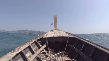 wood : The view from eyes of the tourist. traveling quickly on a wooden boat in the tropical sea. Thailand. Video FullHD