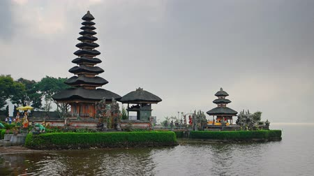 tiered : Old Pura Ulun Danu Bratan temple at the lake in Bali. Indonesia. 4k video with slow panning Stock Footage