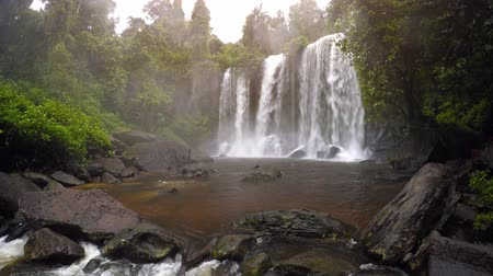 гул : Huge waterfall in the rainforest. Overcast weather. Phnom Kulen National Park. Cambodia