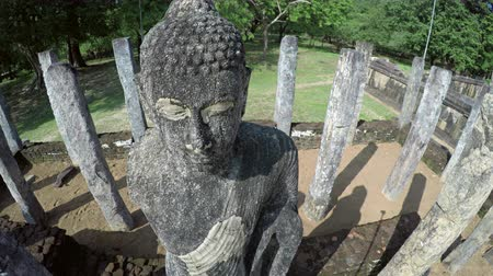 polonnaruwa : Finely detailed face of an ancient. granite statue at a building ruin site in Polonnaruwa. a historical Sri Lankan capital. UltraHD 4k footage Stock Footage