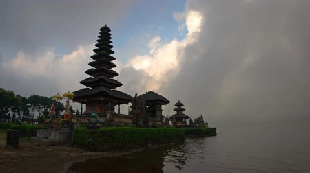 bratan : Pura Ulun Danu Bratan temple in the evening in cloudy weather. Bali. Indonesia. 4k video