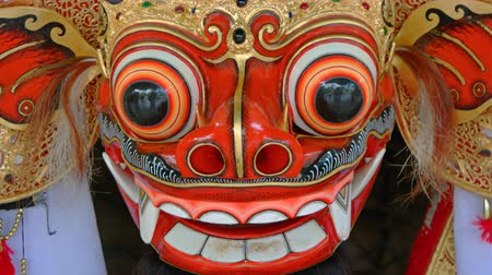 культурный : Closeup of a traditional. highly ornamented. Balinese barong mask. part of a costume for a typical cultural dance. UltraHD 4k footage Стоковые видеозаписи