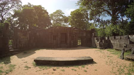 polonnaruwa : Sun glaring down over ancient stone ruins around a royal courtyard in Polonnaruwa. an important historical capital in Sri Lanka.