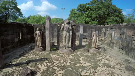 polonnaruwa : Three broken statues on pedistals inside the crumbling walls of an ancient ruin in Polonnaruwa. a historical capital in Sri Lanka.